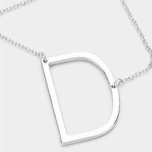 Sideways D necklace